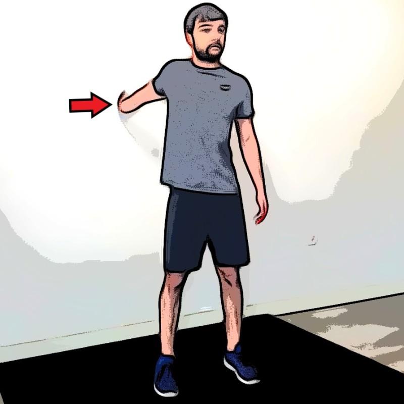 Étirement pectoraux bras en arrière contre un mur - Etape 2